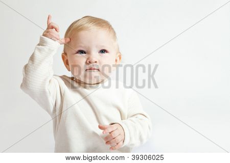 Portrait of cute little girl in white clothes