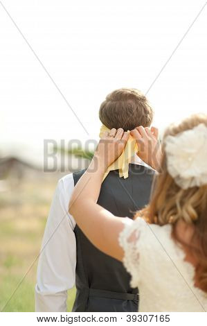 The first look for a groom with a blindfold