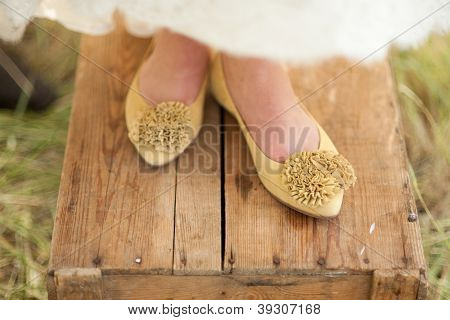 Yellow shoes for a bride