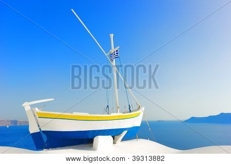 Fishing boat in Oia in Santorini island Greece
