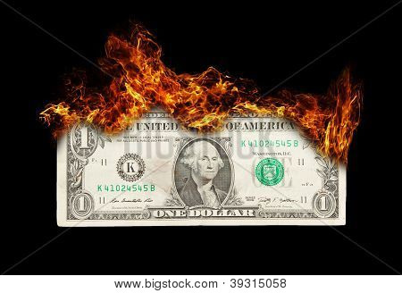 Burning Dollar Bill Symbolizing Careless Money Management