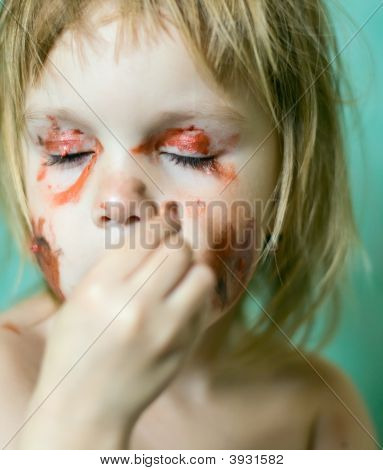 Little Girl Doing Make Up