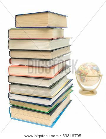 Stack Of Books And A Globe On A White Background