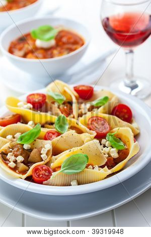 Pasta with vegetable stew with red wine and minestrone soup in back