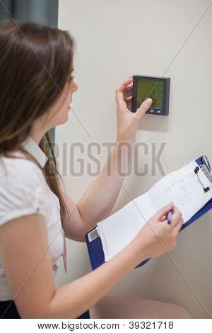 Woman setting temperature in data center