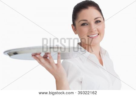 Smiling woman holding empty silver tray