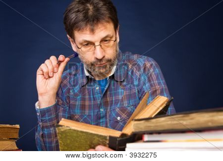 Researcher With The Books