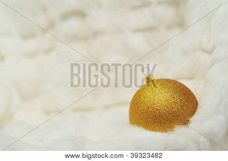 Christmas Background - Golden Ball On White Fur With Space For Text