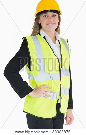 Smiling woman wearing vest and helmet in a suit