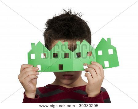 Little Boy Holding Houses Made ??of Paper