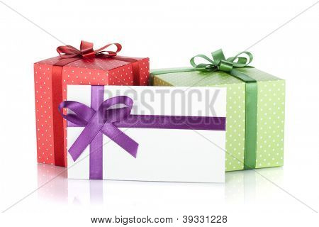 Colorful gift boxes and letter with ribbon and bow. Isolated on white background