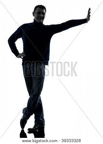 one causasian man leaning smiling friendly  full length in silhouette studio isolated on white background