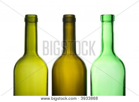 Three Green Empty Wine Bottles