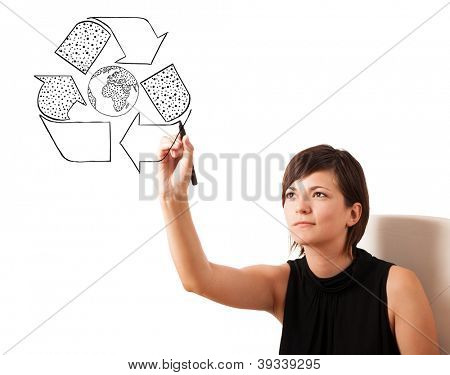 Young woman drawing recycle globe on whiteboard isolated on white