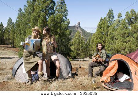 Three Girls In Mountain Landscape