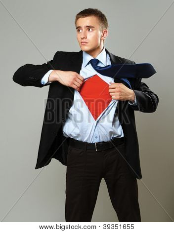 A superhero standing isolated on grey background