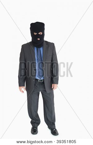 Businessman wearing a balaclava like a thief
