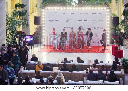 MOSCOW - DECEMBER 15: Interviewers on stage at press-day famous French cabaret Moulin Rouge in Crocus City Mall on December 15, 2011 in Moscow, Russia.