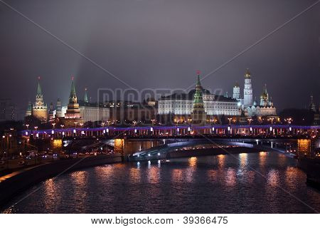 Kremlin view from Patriarshii bridge at winter night in Moscow, Russia.