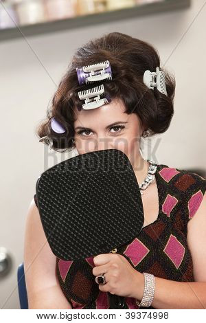 Woman In Curlers Behind Mirror