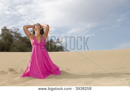 Young Sexy Woman In The Sand