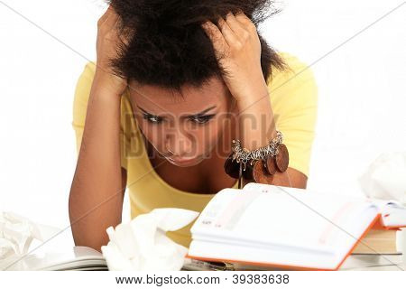 Young black woman tired from studying with books