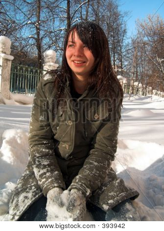 The Girl Sits In A Snow