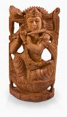 stock photo of radha  - Hindu god Krishna playing the flute sculpture made of sandal wood - JPG