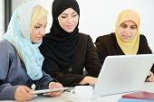 stock photo of middle eastern culture  - Group of Muslim women working - JPG