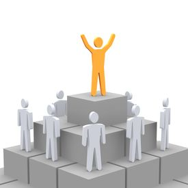 stock photo of human pyramid  - Celebrating person at the top of pyramid - JPG