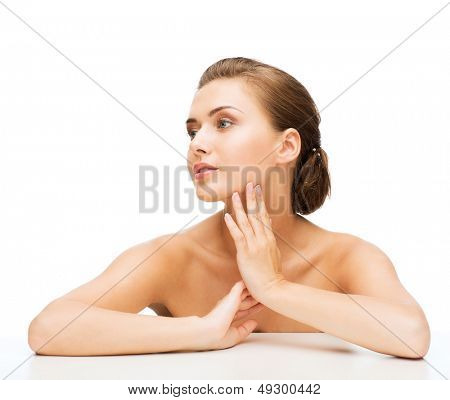 beauty concept - face of beautiful woman with clean perfect skin