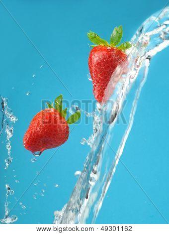 Fresh colored splash with strawberry