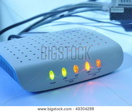 Networking and security concepts. Wireless ADSL router on a white background.