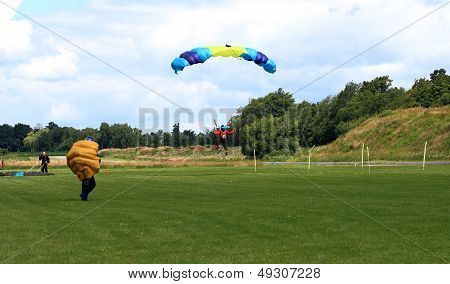 Skydiver In Process Of Landing After The Jump In Formation.