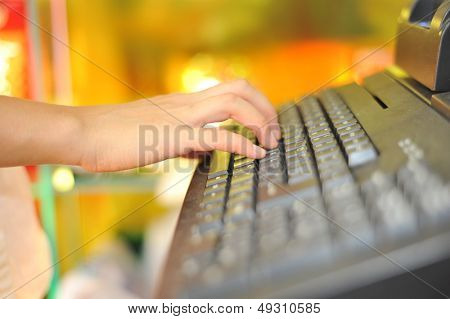 Woman's hand on cash register buttons