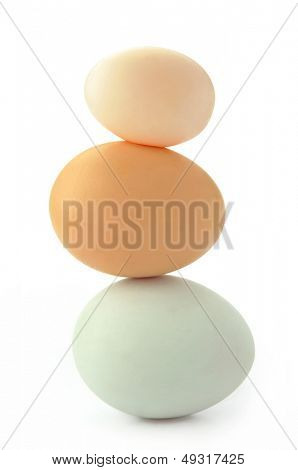 Three eggs standing on top of each other