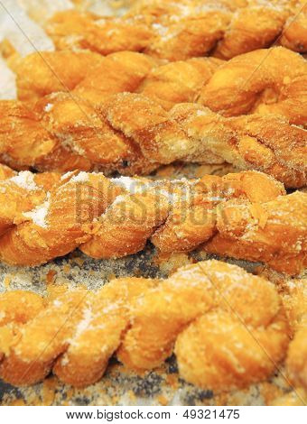 Fried dough twist on white background