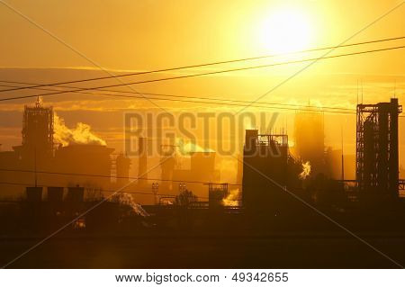steel mill blasting furnaces at sunset