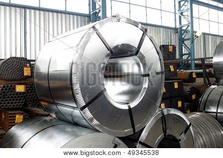 packed rolls of steel sheet in a warehouse