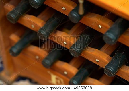 wine bottles in a wooden support