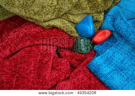 colourful stones and scarves