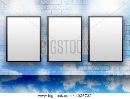 Three Blank White Displays On Cloud Wall
