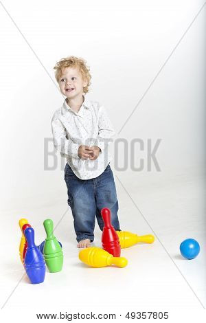 Happy boy is playing with toys