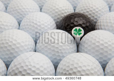 White And Black Golf Balls And Wooden Tee