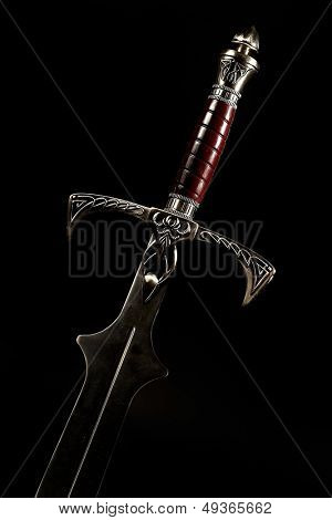 medieval sword against black background