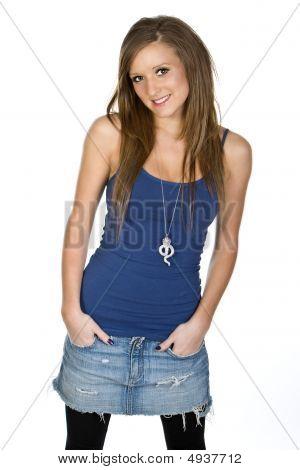 Cute Teenager In Vest And Denim Skirt