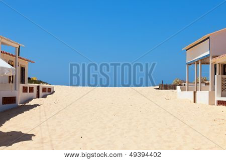 Beach Sand Encroaching On Beachfront Buildings