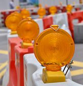stock photo of barricade  - Orange construction light on barricade - JPG