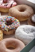 stock photo of jimmy  - Variety of doughnuts in box - JPG