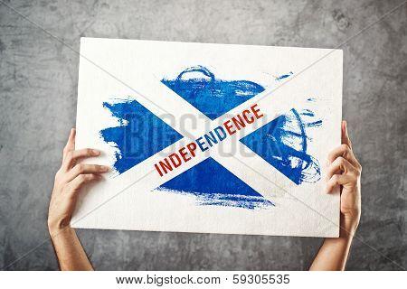 Scotland Independence Flag. Man Holding Banner With Scotish Inde